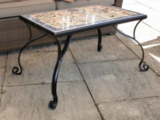 Table with mosaic tiles. Interiors.