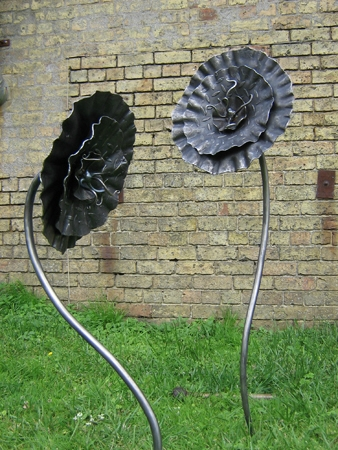 'Checker plate flower'. Garden sculpture.